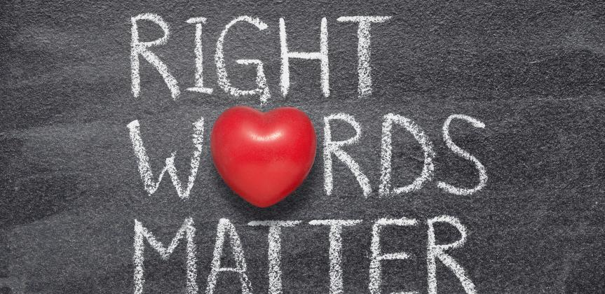 "A blackboard with the words ""Right Words Matter"" written in chalk"