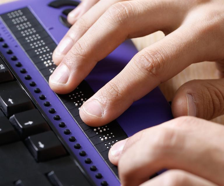 close up photo of person using assistive technology