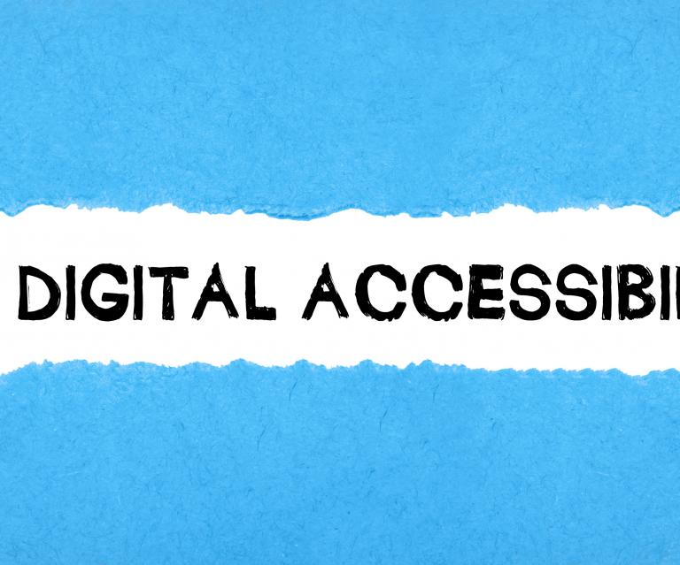 "The words: ""Digital Accessibility"" under a sheet of paper that's been peeled back."