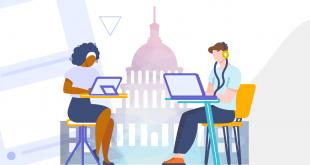 capital building in background as 2 people work on laptops